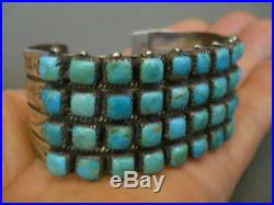 Vintage Native American Turquoise Row Sterling Silver Cuff Bracelet Signed SWM